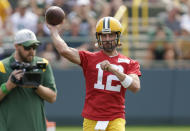 CORRECTS DATE Green Bay Packers' quarterback Aaron Rodgers passes during NFL football training camp Wednesday, July 28, 2021, in Green Bay, Wis. (AP Photo/Matt Ludtke)