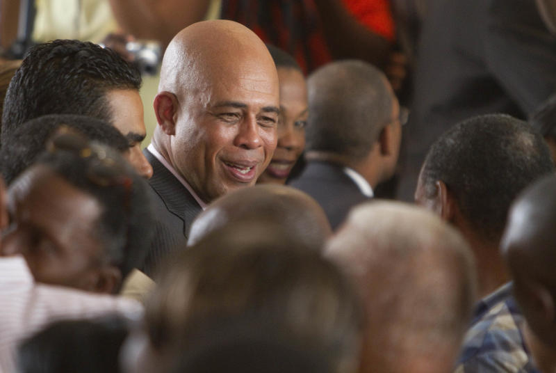 Haiti's presidential candidate Michel 'Sweet Micky' Martelly greets supporters after giving a press conference in Port-au-Prince, Haiti, Tuesday April 5, 2011. Martelly captured nearly 68 percent of the vote in the presidential election runoff, defeating opposition leader and former first lady Mirlande Manigat, according to preliminary election results released Monday night.  (AP Photo/Ramon Espinosa)