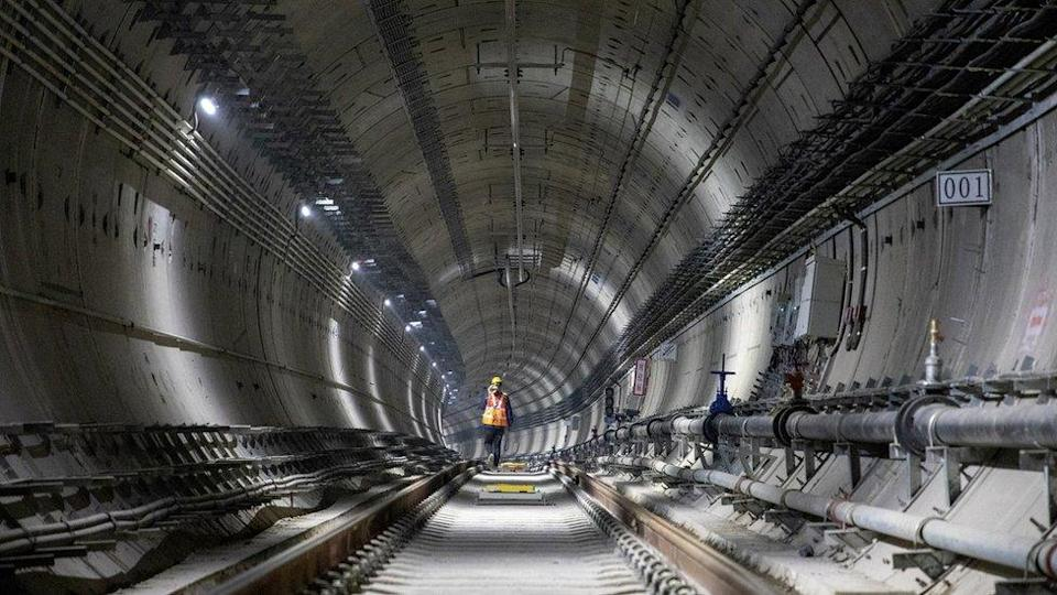 A worker walks in a tunnel at the construction site of a subway on December 18, 2020 in Zhengzhou, Henan Province of China.