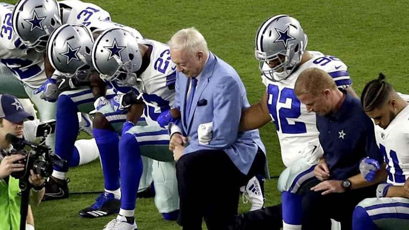 Cowboys take a knee before the national anthem. Pic: Yahoo US