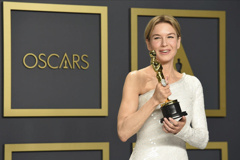 "FILE - Renee Zellweger, winner of the award for best performance by an actress in a leading role for ""Judy"", poses in the press room at the Oscars on Feb. 9, 2020, in Los Angeles. Zellweger has earned her first Grammy nomination this year. The ""Judy"" soundtrack, which features Zellweger covering songs like ""Over the Rainbow"" and ""The Trolley Song,"" is nominated for best traditional pop vocal album. (Photo by Jordan Strauss/Invision/AP, File)"