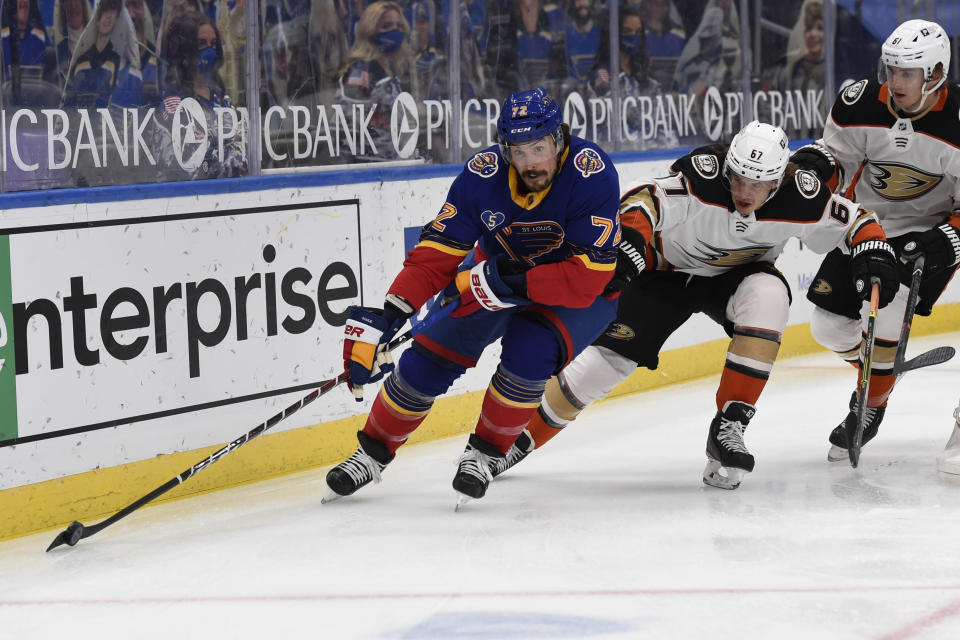 Anaheim Ducks' Rickard Rakell (67) pressures St. Louis Blues' Justin Faulk (72) during the first period of an NHL hockey game on Wednesday, May 5, 2021, in St. Louis. (AP Photo/Joe Puetz)