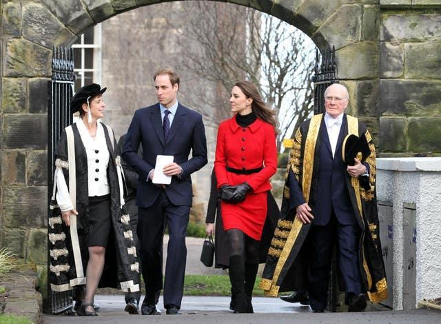 Prince William and Kate Middleton pass St Salvator's halls, accompanied by Sir Menzies Campbell (right), during their return visit (Andrew Milligan/PA)