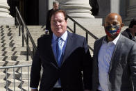 Chicago banker Stephen Calk, left, leaves Federal court in New York, Thursday, June 24, 2021. He is on trial on charges he tried to buy himself a senior post in former President Donald Trump's administration by making risky loans to Trump onetime campaign chairman, Paul Manafort. (AP Photo/Richard Drew)