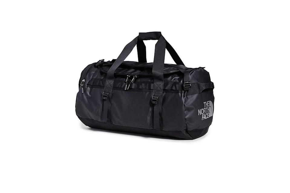 "$139, East Dane. <a href=""https://www.eastdane.com/medium-base-camp-duffel-north/vp/v=1/1517772129.htm?folderID=19406&colorId=161F6"" rel=""nofollow noopener"" target=""_blank"" data-ylk=""slk:Get it now!"" class=""link rapid-noclick-resp"">Get it now!</a>"