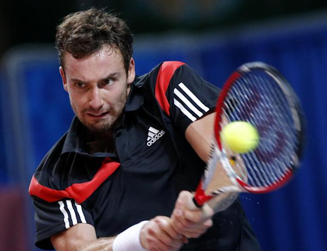 Ernests Gulbis of Latvia returns the ball to Guillermo Garcia-Lopez of Spain during the St. Petersburg Open ATP tennis tournament final match in St.Petersburg, Russia, Sunday, Sept. 22, 2013. (AP Photo/Dmitry Lovetsky)