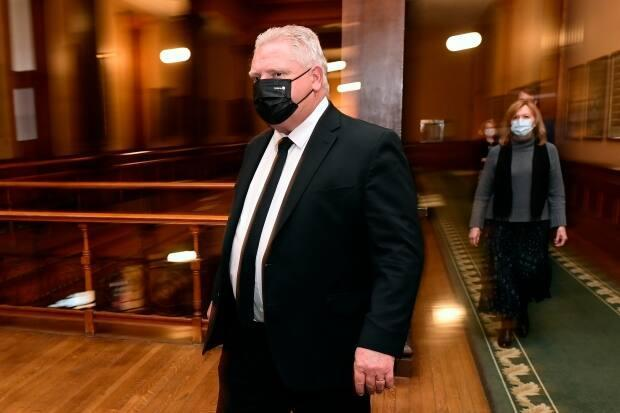 Ontario Premier Doug Ford and Health Minister Christine Elliott walk to a news conference at Queen's Park on Friday, April 16. Both have written to the federal government asking for stricter measures at borders.