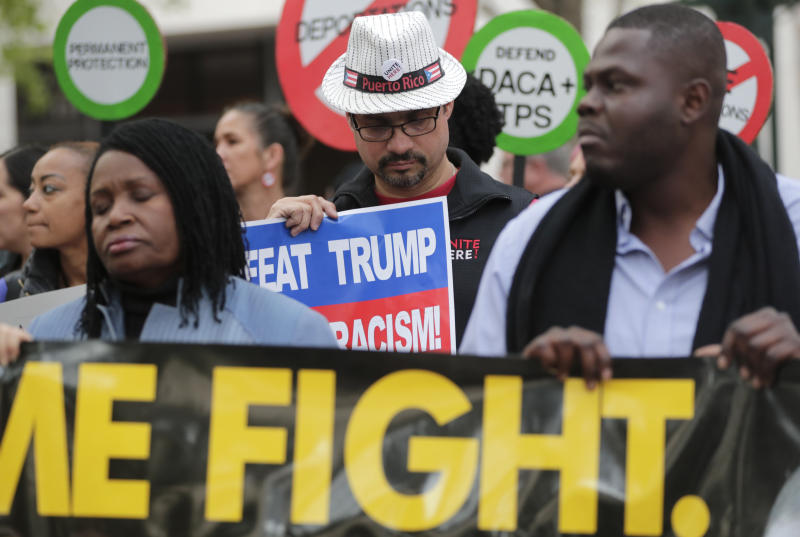 Rick Sanchez, of Miami, center, pauses for a moment of silence during a rally in support of Deferred Action for Childhood Arrivals (DACA) and Temporary Protected Status (TPS) programs Wednesday, Jan. 17, 2018, in Miami. (AP Photo/Lynne Sladky)
