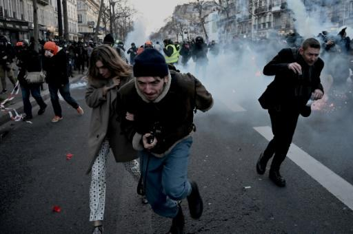 """Several stores were ransacked as marchers brandished union flags and chanted defiantly: """"We are still here!"""" and """"Macron resign"""""""