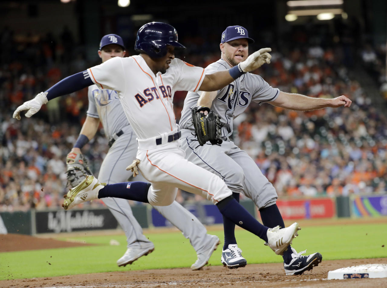 Houston Astros' Tony Kemp, left, beats Tampa Bay Rays relief pitcher Jonny Venters to first base for a hit during the third inning of a baseball game Monday, June 18, 2018, in Houston. (AP Photo/David J. Phillip)