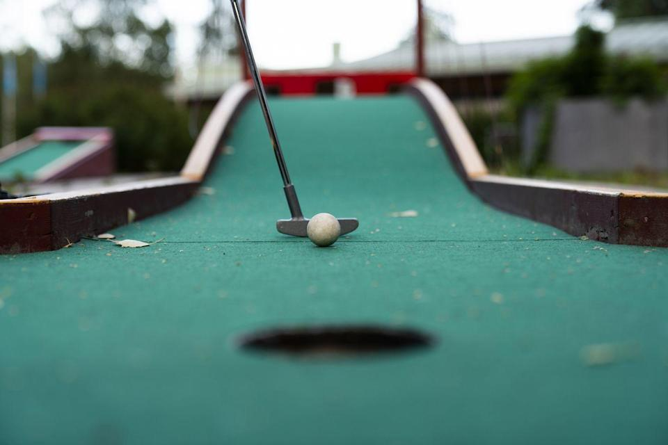 <p>It's cute and nostalgic, and it gives you an excuse to get really close when showing your partner how to swing that club properly. </p>