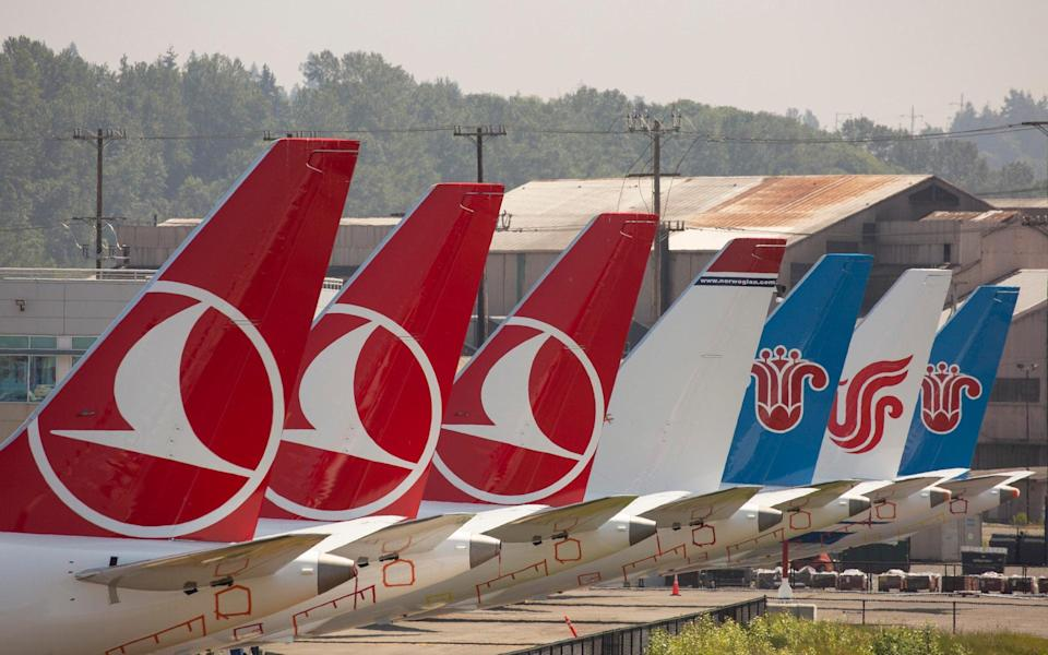737 Max aircraft sit parked at a Boeing facility known as Boeing Field, in Seattle - Getty