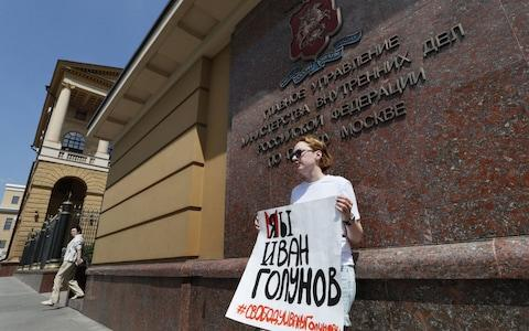 A picketer protests in support of Mr Golunov earlier on Tuesday - Credit: Yuri Kochetkov/EPA-EFE/REX