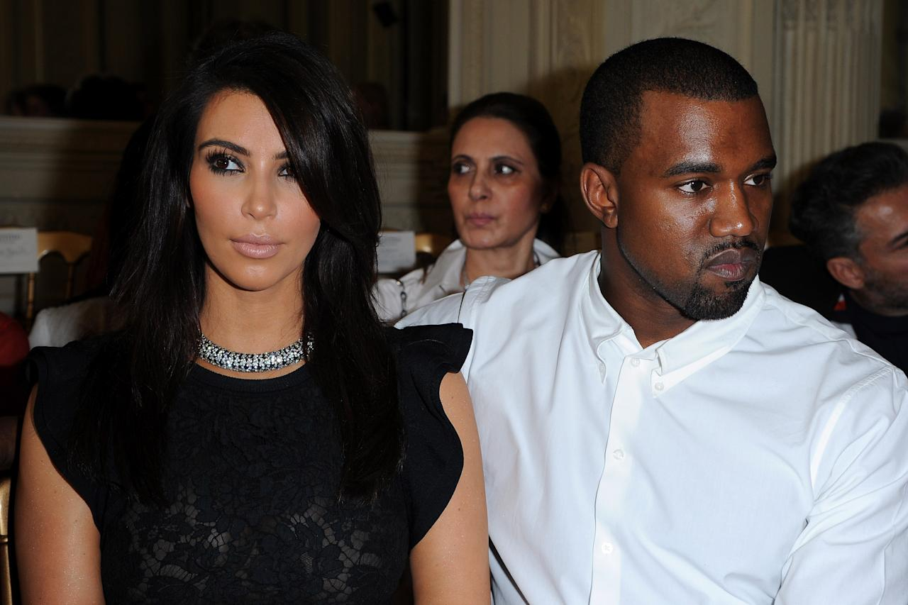 PARIS, FRANCE - JULY 04:  Kim Kardashian and Kayne West attend the Valentino  Haute-Couture show as part of Paris Fashion Week Fall / Winter 2012/13 at Hotel Salomon de Rothschild on July 4, 2012 in Paris, France.  (Photo by Pascal Le Segretain/Getty Images)