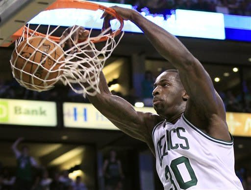 Boston Celtics forward Brandon Bass dunks against the Philadelphia 76ers during the second quarter of Game 7 in an NBA basketball Eastern Conference semifinal playoff series, Saturday, May 26, 2012, in Boston. (AP Photo/Elise Amendola)