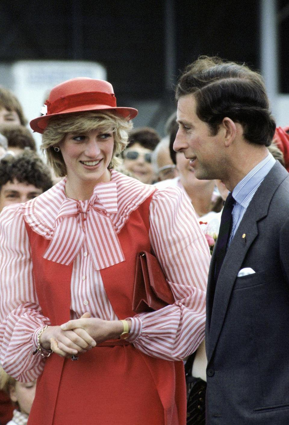 """<p>During <a href=""""https://www.townandcountrymag.com/society/tradition/a29339734/princess-diana-prince-charles-1983-australia-tour-the-crown/"""" rel=""""nofollow noopener"""" target=""""_blank"""" data-ylk=""""slk:an official visit to Australia"""" class=""""link rapid-noclick-resp"""">an official visit to Australia</a>, Diana chose a red and white striped outfit made by designer Bellville Sassoon. The playful look involved a coordinating red vest, skirt, and hat. Charles, too, opted for stripes, with his blue and white striped button-down. </p>"""