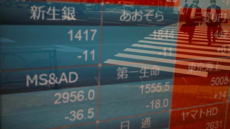 China's stocks surge on economic recovery sign as bulls return from 'golden week' holiday, Hang Seng Index retreats on virus concerns