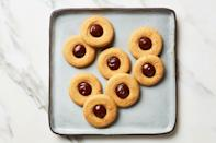"""Upgrade the typical chocolate candy center of these peanut butter cookies with a dollop of rich, silky ganache. <a href=""""https://www.epicurious.com/recipes/food/views/peanut-butter-better-blossoms?mbid=synd_yahoo_rss"""" rel=""""nofollow noopener"""" target=""""_blank"""" data-ylk=""""slk:See recipe."""" class=""""link rapid-noclick-resp"""">See recipe.</a>"""