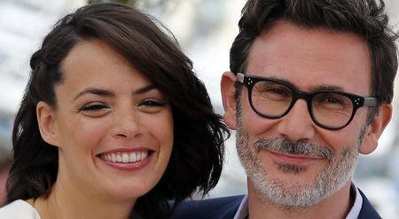 """Director Michel Hazanavicius and cast member Berenice Bejo pose during a photocall for the film """"The Search"""" in competition at the 67th Cannes Film Festival"""