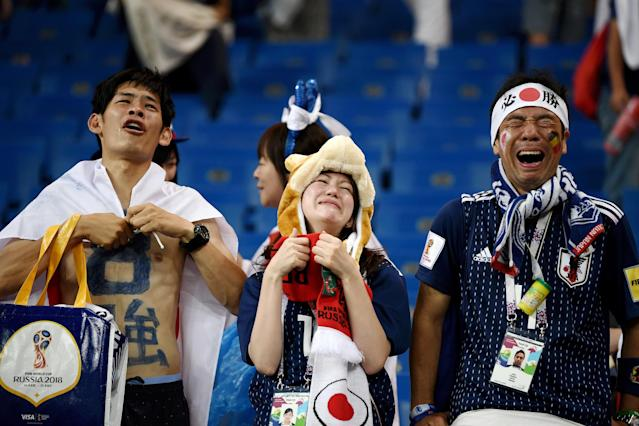 <p>Japan fans look dejected following their sides defeat in the 2018 FIFA World Cup Russia Round of 16 match between Belgium and Japan at Rostov Arena on July 2, 2018 in Rostov-on-Don, Russia. (Photo by Carl Court/Getty Images) </p>