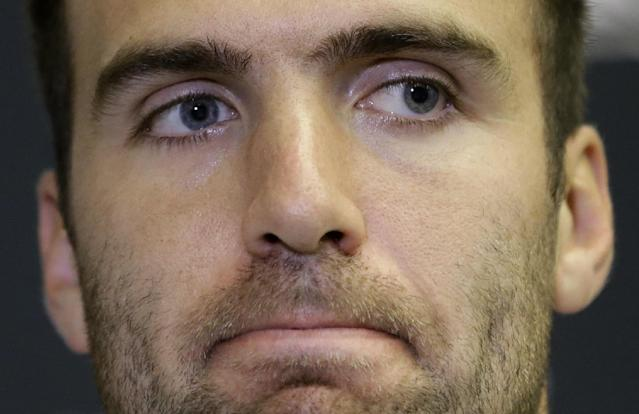 Baltimore Ravens quarterback Joe Flacco speaks at a news conference after an NFL football organized team activity, Thursday, May 29, 2014, at the team's practice facility in Owings Mills, Md. (AP Photo/Patrick Semansky)
