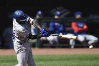 Texas Rangers Adolis Garcia connects for a single against the Baltimore Orioles in the first inning of a baseball game Sunday, Sept. 26, 2021, in Baltimore. (AP Photo/Gail Burton)