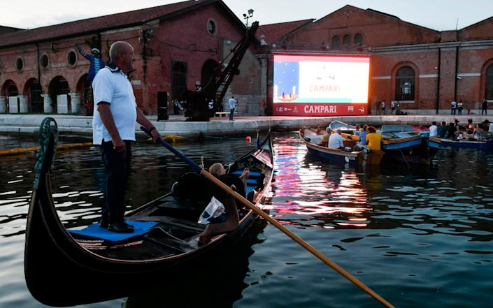 Italy's first drive-in cinema with boats at Arsenal Dock in Venice - AFP