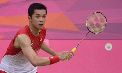 Taufik Hidayat of Indonesia plays a shot during men's singles badminton match against Pablo Abian of Spain