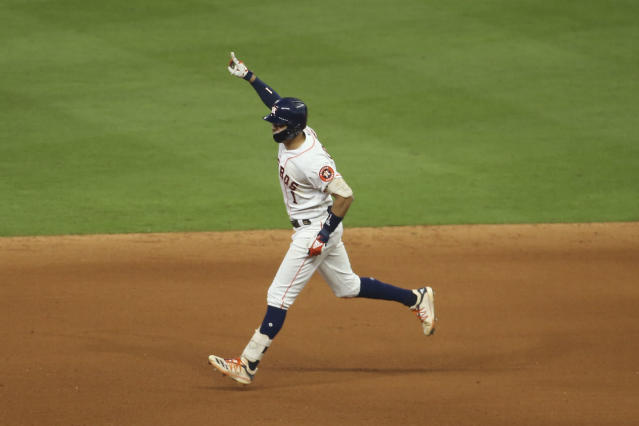 Houston Astros shortstop Carlos Correa points to the sky after his walk-off homer in Game 2 of the ALCS vs. the Yankees. (Troy Taormina-USA TODAY Sports)
