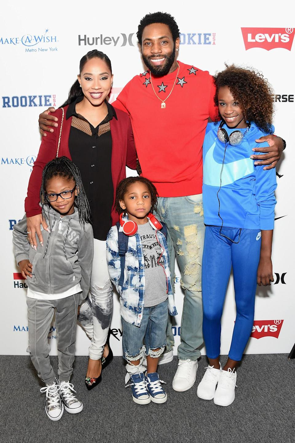 Terricka and Antonio Cromartie with three of their children. (Photo: Michael Loccisano/Getty Images for New York Fashion Week: The Shows)