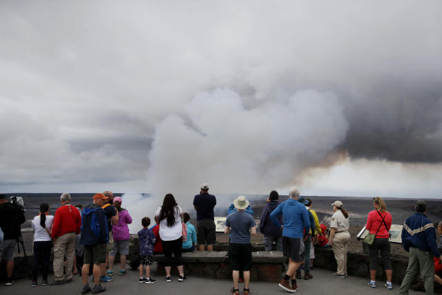 <p>Visitors watch as steam and gas rise from Kilauea's summit crater in Volcanoes National Park, Hawaii, Wednesday, May 9, 2018. (Photo: Jae C. Hong/AP) </p>