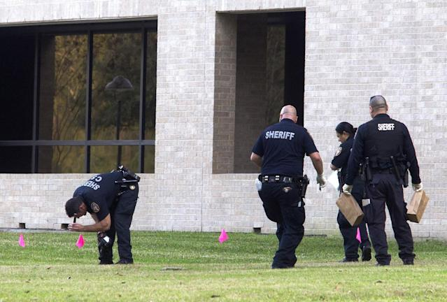 Police collect evidence after a shooting happened on Lone Star College North Harris campus on Tuesday January 22, in Houston. The shooting at a community college wounded three people Tuesday and sent some students fleeing for safety while others with medical training helped tend the wounded. (AP Photo/ Patric Schneider)