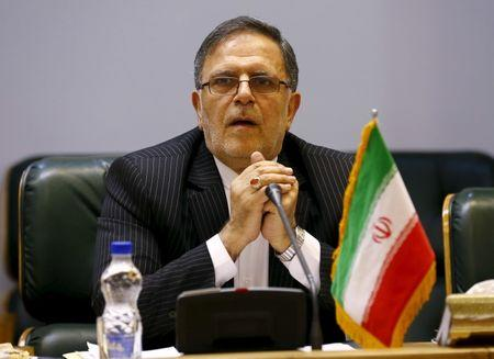FILE PHOTO: Valiollah Seif, Governor of Central Bank of Iran, waits to start a meeting with Britain's Foreign Secretary Philip Hammond in Tehran