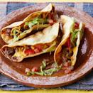 """<p>The best part of tacos are the extras! Add some refried beans to your taco shells instead of serving them as a side dish. For extra flavor, warm up the beans with some shredded cheese. <br></p><p><a href=""""https://www.thepioneerwoman.com/food-cooking/recipes/a35726509/fried-beef-tacos/"""" rel=""""nofollow noopener"""" target=""""_blank"""" data-ylk=""""slk:Get Ree's recipe."""" class=""""link rapid-noclick-resp""""><strong>Get Ree's recipe. </strong></a></p>"""