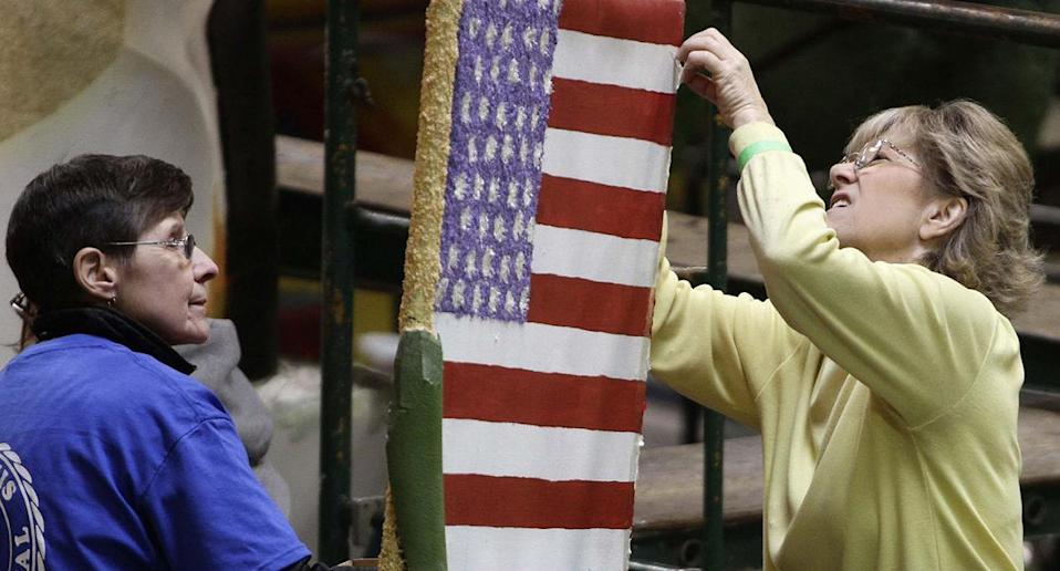 Volunteers at Phoenix Decorating work on an American flag that will be on a Tournament of Roses Parade float in Pasadena, California. (Reuters)