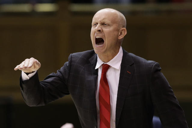 Louisville coach Chris Mack yells during the first half of the team's NCAA college basketball game against Duke in Durham, N.C., Saturday, Jan. 18, 2020. (AP Photo/Gerry Broome)