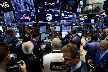 FILE PHOTO: The AT&T logo is seen on a monitor near traders on the floor of the New York Stock Exchange (NYSE) in New York City, U.S. June 13, 2018.  REUTERS/Brendan McDermid