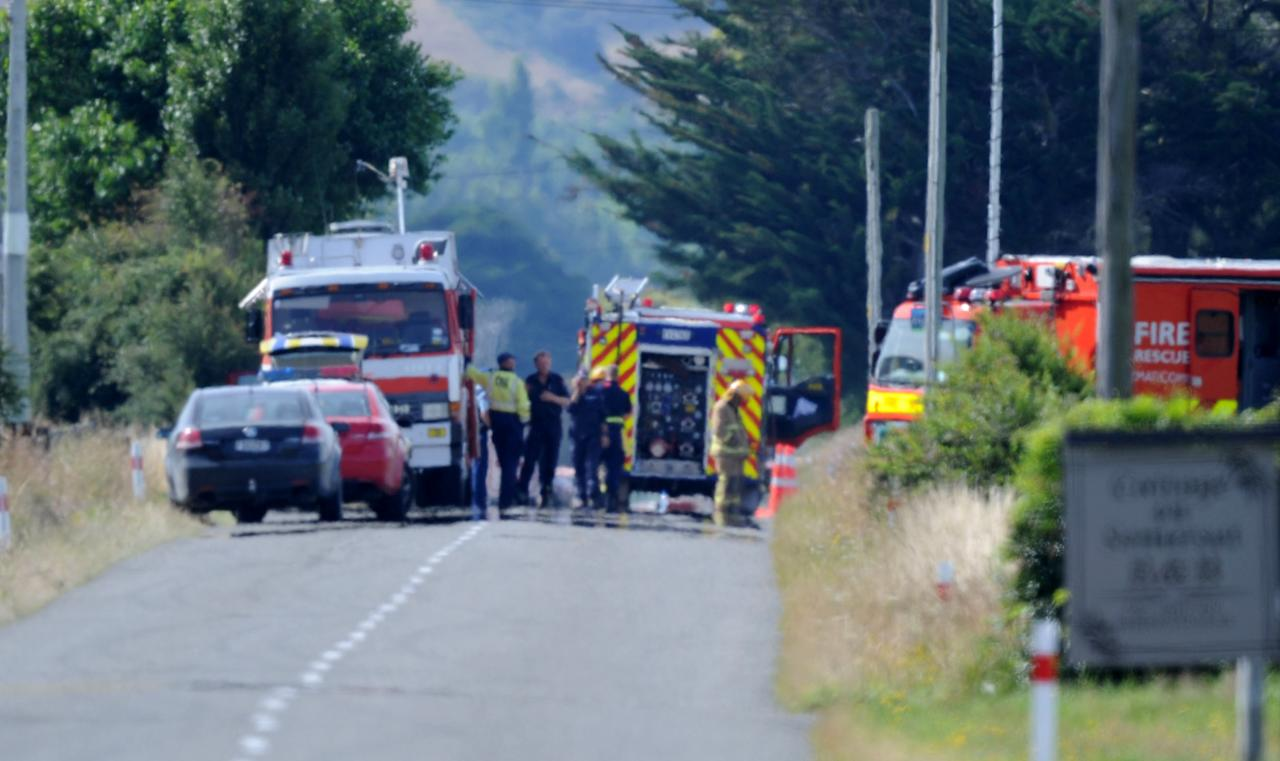 Police cordon off the area after a hot air balloon caught fire and the ten passengers and pilot were killed, in Carterton, New Zealand, Saturday, Jan. 7, 2012. A hot air balloon crashed and killed all 11 people aboard near the rural town of Carterton, some 94 miles (150 kilometers) north of the capital, Wellington, officials said Saturday. (AP Photo/SNPA/Ross Setford) NEW ZEALAND OUT