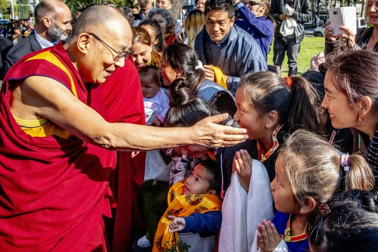 The Dalai Lama meeting  fans and faithful after arriving  in Rotterdam on Friday