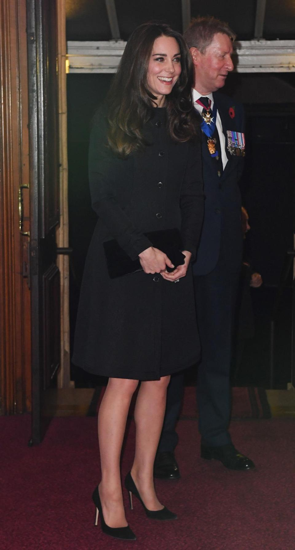 <p>Kate donned a black evening coat by Temperley London for the Festival of Remembrance. Hitting just above the knee, the ensemble was perfect for the Duchess. She paired the design with a velvet bow clutch and black Gianvito Rossi heels. </p><p><i>[Photo: PA]</i></p>