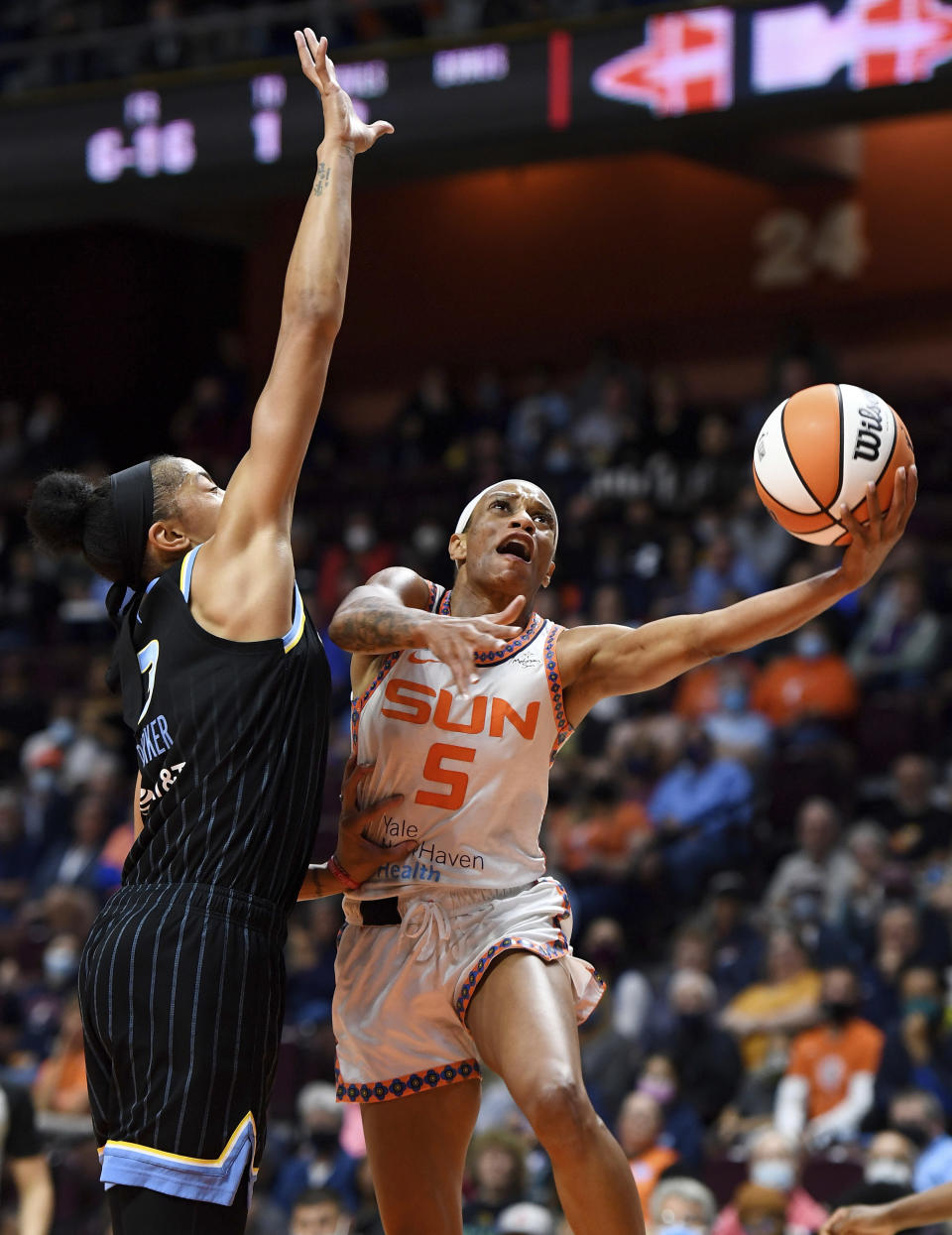 Connecticut Sun guard Jasmine Thomas puts up a shot as Chicago Sky Candace Parker defends during a WNBA semifinal playoff basketball game, Tuesday, Sept. 28, 2021, at Mohegan Sun Arena in Uncasville, Conn. (Sean D. Elliot/The Day via AP)