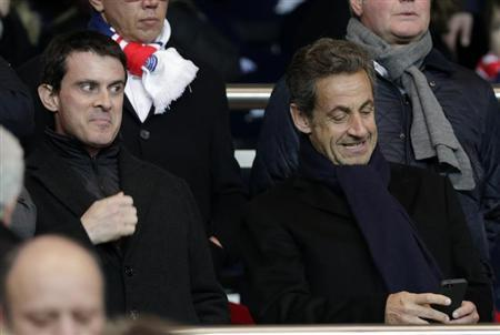 French Interior Minister Valls and Former French President Sarkozy attend the French Ligue 1 soccer match between Paris Saint-Germain and Olympique Marseille at the Parc des Princes stadium in Paris