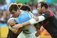 Argentina's Facundo Isa (C) is tackled by Georgia's captain Mamuka Gorgodze during their Rugby World Cup Pool C match, at Kingsholm stadium in Gloucester, on September 25, 2015 (AFP Photo/Loic Venance)