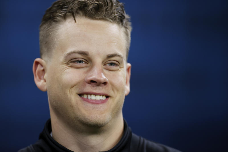 Joe Burrow smiles during the NFL Scouting Combine.