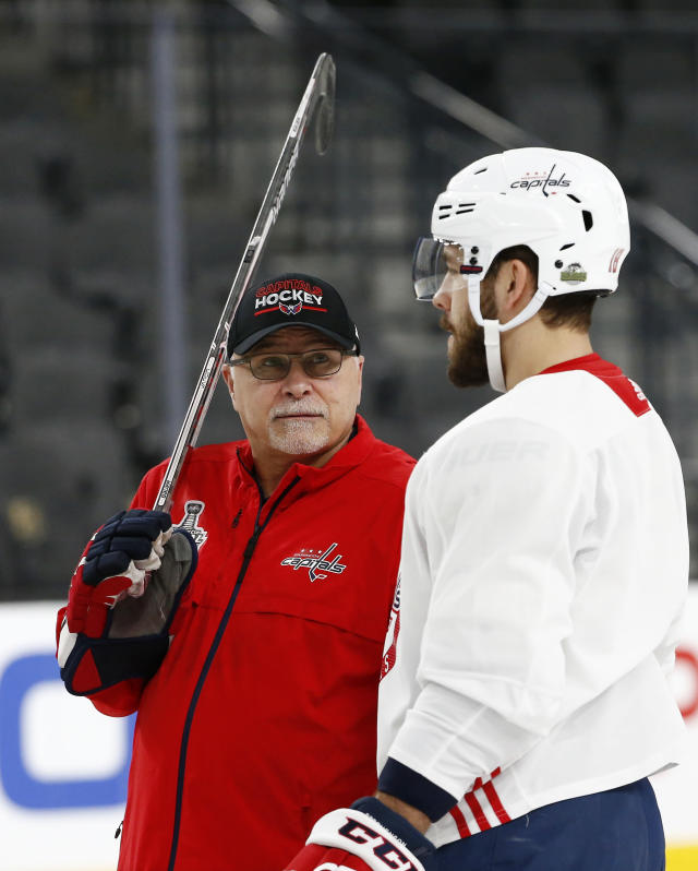 Washington Capitals head coach Barry Trotz, left, talks with center Chandler Stephenson during practice Tuesday, May 29, 2018, in Las Vegas. Game 2 of the Stanley Cup NHL hockey finals between Capitals and the Vegas Golden Knights is scheduled for Wednesday. (AP Photo/Ross D. Franklin)