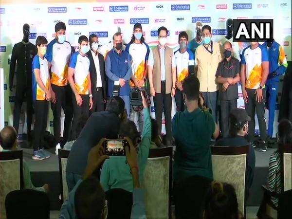 IOA chief Batra, Sports Minister Rijiju and athletes at the unveiling of India's Olympic uniform