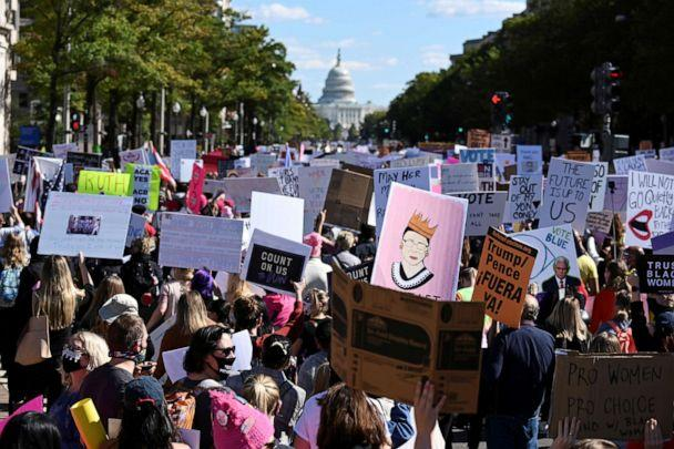 PHOTO: People participate in a nationwide Women's March in honor of the late late Justice Ruth Bader Ginsburg before the 2020 election, in Washington, Oct. 17, 2020. (Erin Scott/Reuters)