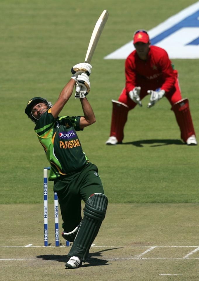 Pakistan's batsman Shahid Afridi goes for a big shot during the first game of the three match ODI cricket series between Pakistan and Zimbabwe at the Harare Sports Club on August 27, 2013. AFP PHOTO / JEKESAI NJIKIZANA        (Photo credit should read JEKESAI NJIKIZANA/AFP/Getty Images)