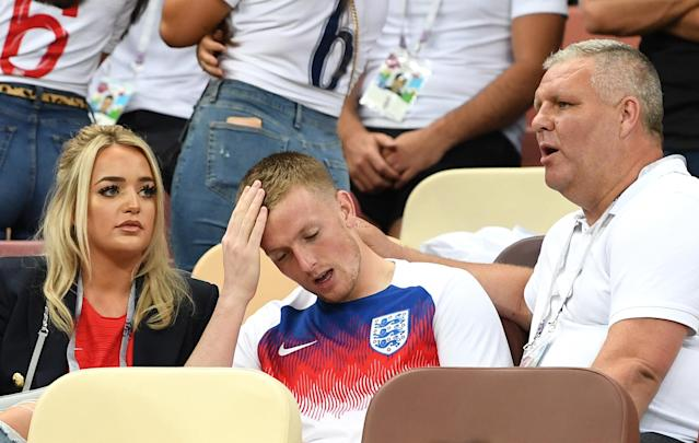 <p>Jordan Pickford holds his head in his hands. </p>