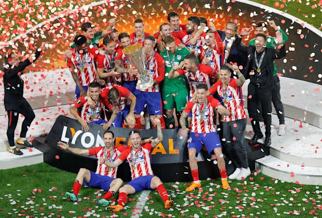 Soccer Football - Europa League Final - Olympique de Marseille vs Atletico Madrid - Groupama Stadium, Lyon, France - May 16, 2018 Atletico Madrid players celebrate with the trophy after winning the Europa League REUTERS/Vincent Kessler